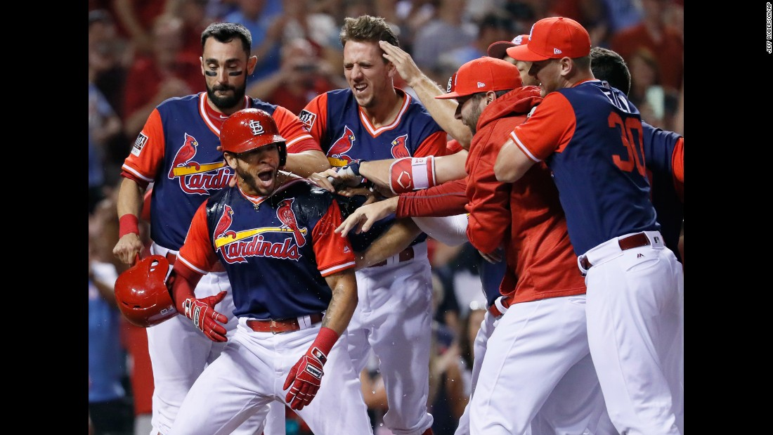 St. Louis' Tommy Pham is congratulated by teammates after hitting a walk-off home run against Tampa Bay on Saturday, August 26.