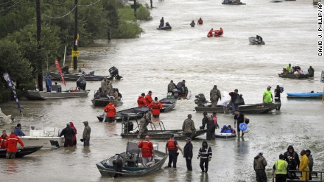 Rescue boats fill Tidwell Road as they help flood victims evacuate as floodwaters from Tropical Storm Harvey rise Monday, Aug. 28, 2017, in Houston. (AP Photo/David J. Phillip