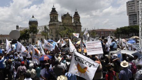 Members of the Peasant Development Committee (CODECA) take part in a demonstration demanding Guatemalan President Jimmy Morales' resignation and in support of the head of the International Commission Against Impunity in Guatemala (CICIG), Ivan Velasquez of Colombia, outside the Culture Palace in Guatemala City on August 28, 2017.  Guatemala faced a fresh political crisis Sunday as President Morales tried to expel a UN official investigating him for suspected corruption, but was overruled by the courts. / AFP PHOTO / JOHAN ORDONEZ        (Photo credit should read JOHAN ORDONEZ/AFP/Getty Images)