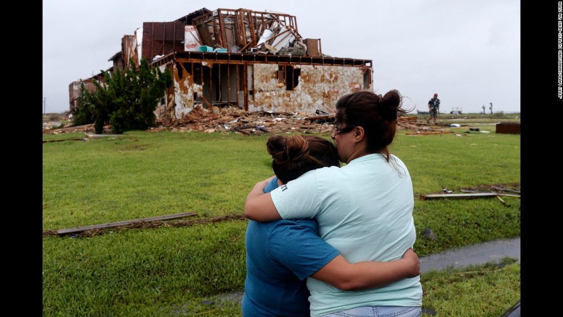 Julie Martinez, right, hugs her daughter, Gabrielle Jackson, in front of a relative's damaged apartment in Rockport on August 28.