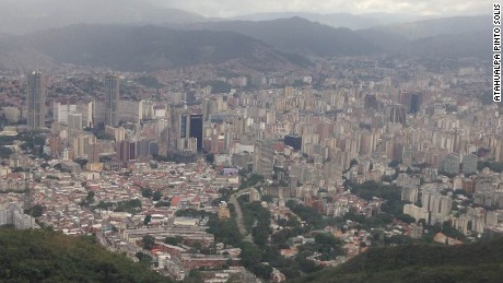Caracas, seen from from the surrounding hills, sprawls out in the valley below.