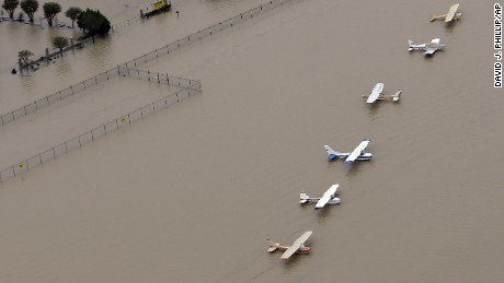 Airplanes sit at a flooded airport near the Addicks Reservoir as floodwaters from Tropical Storm Harvey rise Tuesday, Aug. 29, 2017, in Houston. (AP Photo/David J. Phillip)