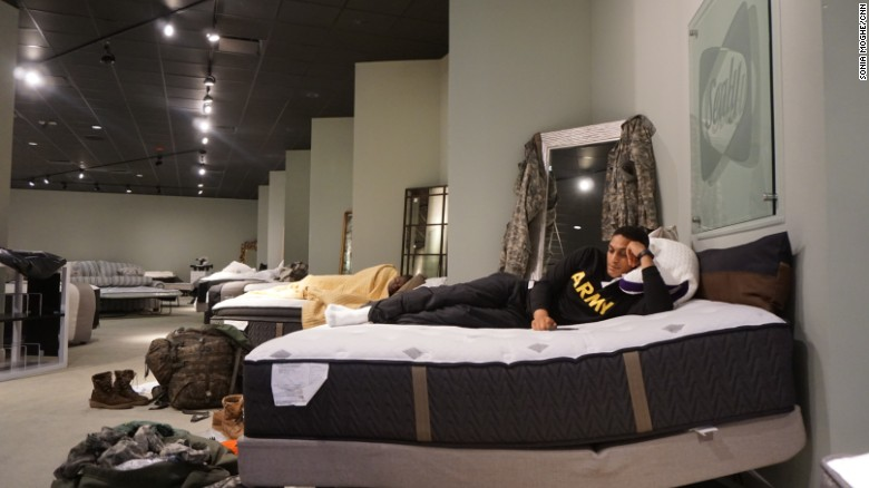 Aziz Shroff  23  with the Texas National Guard  rests on a furniture store. Gallery Furniture store turns into Houston shelter   CNN