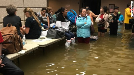 Evacuees at a Port Arthur emergency shelter battle flooding once more after leaving their homes.