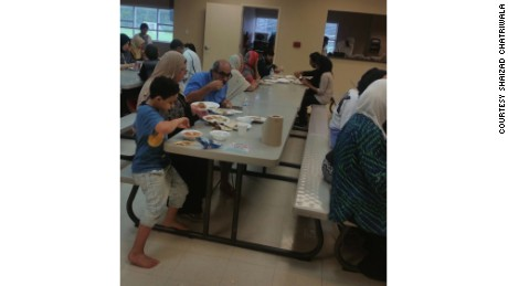 Evacuees eat at the Brand Lane Islamic Center in Stafford, Texas, which served as a Hurricane Harvey shelter.