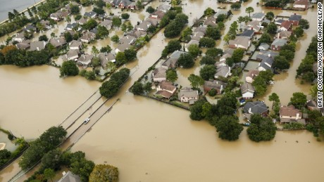 Floodwaters from the Addicks Reservoir inundate a neighborhood off N. Eldridge Parkway in the aftermath of Tropical Storm Harvey on Wednesday, Aug. 30, 2017, in Houston. (Brett Coomer/Houston Chronicle via AP