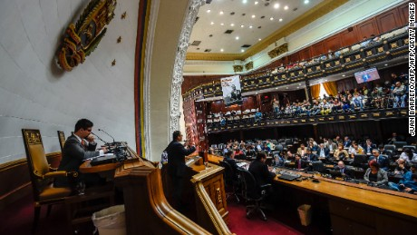 The First Vice-President of the Venezuelan National Assembly Freddy Guevara (L), attends a session at the National Assembly in Caracas on August 19, 2017. Venezuela's new pro-government constitutional authority declared Friday it was seizing power from the opposition-led legislature, tightening President Nicolas Maduro's grip on the country in defiance of international outrage. It was the latest maneuver in a deadly political crisis that has seen Maduro branded a dictator by opponents, whom he in turn accuses of plotting with the United States to overthrow him. The opposition-led National Assembly rejected the move.  / AFP PHOTO / Juan BARRETO        (Photo credit should read JUAN BARRETO/AFP/Getty Images)