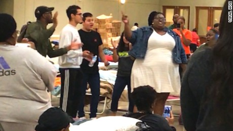 Gospel singers lift spirits at shelter for Harvey evacuees