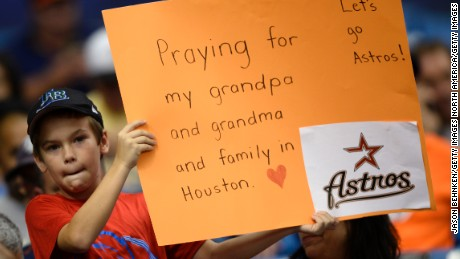 ST. PETERSBURG, FL - AUGUST 29:  A young fan shows his support for family in Houston during the Texas Rangers versus Houston Astros game at Tropicana Field on August 29, 2017 in St. Petersburg, Florida. (Photo by Jason Behnken / Getty Images)