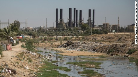 Sewage water runs next to Gaza Strip's power plant at Nuseirat, in the central Gaza Strip, on June 10, 2017. / AFP PHOTO / FP / Mahmud Hams        (Photo credit should read MAHMUD HAMS/AFP/Getty Images)