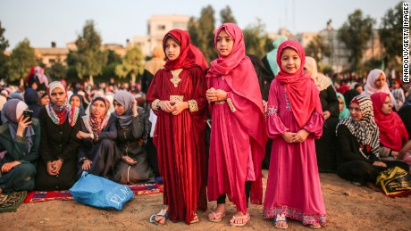 Muslims gather to perform the Eid al-Adha prayer at Es-Saraya Square in Gaza City, Gaza.