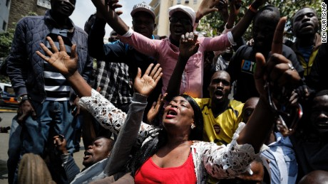 Supporters of opposition leader Raila Odinga kneel down and thank God as they celebrate after hearing the verdict, on a street opposite the Supreme Court in downtown Nairobi, Kenya Friday, Sept. 1, 2017. Kenya's Supreme Court on Friday nullified President Uhuru Kenyatta's election win last month and called for new elections within 60 days, shocking a country that had been braced for further protests by opposition supporters. (AP Photo/Ben Curtis)