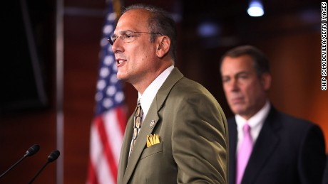 WASHINGTON, DC - SEPTEMBER 23:  Rep. Tom Marino (R-PA) (L) speaks during a news conference about the budget continuing resolution passed by the House near midnight with Speaker of the House Rep. John Boehner (R-OH) (C) and Rep. Lou Barletta (R-PA) September 23, 2011 in Washington, DC.