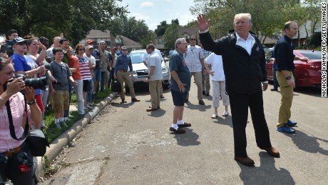 US President Donald Trump visit a neighborhood in Houston while touring areas affected by Hurricane Harvey on September 2.