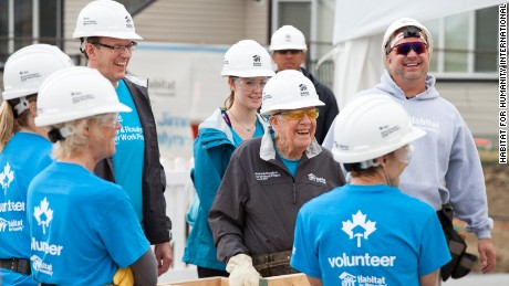 Jimmy Carter (center, in dark jacket) during a Habitat for Humanity project in July.
