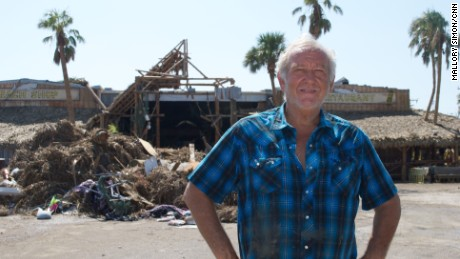 Ed Ziegler stands by his restaurant, now a ruin after Hurricane Harvey.