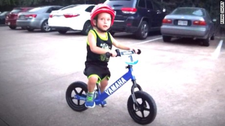 Houston flooding return father son bike valencia pkg_00000000.jpg