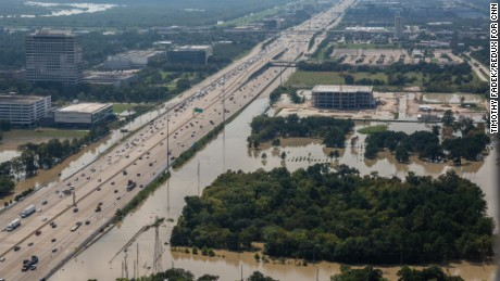 Main roads into Houston are open again, bringing people back to flooded neighborhoods.