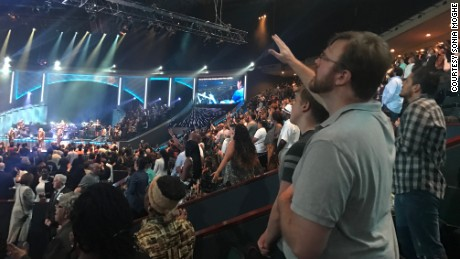 Darrin LeRoy worshipping Sunday at Lakewood Church in Texas
