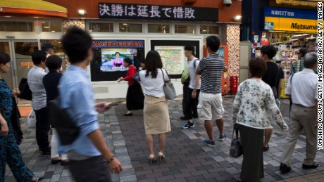 TOKYO, JAPAN - SEPTEMBER 03:  Pedestrians watch a monitor showing a news program reporting on North Korea's 6th nuclear test on September 3, 2017 in Tokyo, Japan. South Korea, Japan and the U.S. detected an artificial earthquake from Kilju, northern Hamgyong Province of North Korea. State news agency KCNA announced Pyongyang have successfully carried out a test of a hydrogen bomb, which could be loaded to the Intercontinental Ballistic Missile (ICBM) missile. (Photo by Tomohiro Ohsumi/Getty Images)