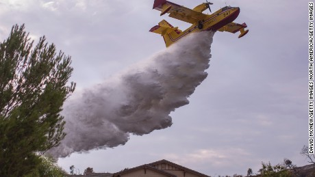 A Super Scooper CL-415 firefighting aircraft from Canada is helping protect homes.