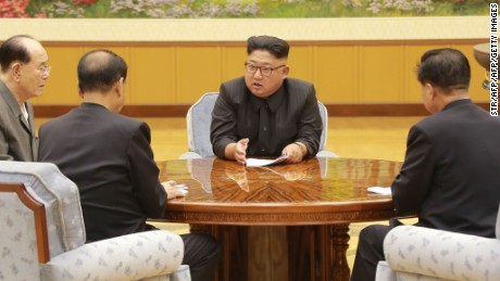 This picture was released by North Korea's official Korean Central News Agency (KCNA) on September 4, 2017 shows North Korean leader Kim Jong-Un (C) attending a meeting with a committee of the Workers' Party of Korea about the test of a hydrogen bomb, at an unknown location.
