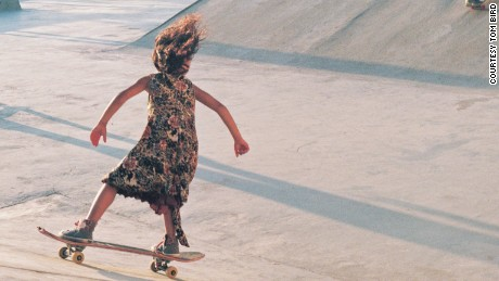 A young girl rides a skateboard in one of the West Bank's custom built skate parks.