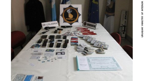 "Italian mobster Rocco Morabito's arsenal of ID cards, credit cards and cell phones. The so-called ""King of Cocaine"" was arrested after evading authorities for more than 20 years."