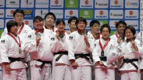 Japanese judoka celebrate winning Sunday's team event at the World Judo Championships