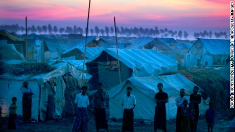 Rohingya refugees stand at a crowded camp in 2012 on the outskirts of Sittwe, Myanmar.