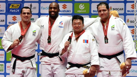Mongolia's Naidan Tuvshinbayar poses with his bronze medal alongside Riner, Tushishvili and Brazil's Rafaela Silva in Budapest.