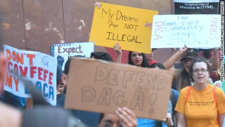 Young immigrants and supporters walk holding signs during a rally in support of Deferred Action for Childhood Arrivals (DACA) in Los Angeles, California on September 1, 2017. A decision is expected in coming days on whether US President Trump will end the program by his predecessor, former President Obama, on DACA which has protected some 800,000 undocumented immigrants, also known as Dreamers, since 2012. / AFP PHOTO / FREDERIC J. BROWN        (Photo credit should read FREDERIC J. BROWN/AFP/Getty Images)