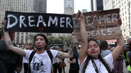 "Gloria Mendoza wipes back tears as she protests with Jovan Rodrigo and other ""Dreamers"" near Trump Tower in New York City on September 5 after the Trump administration announced its decision to end the DACA program."