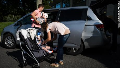 Christian and Nicole McDonald load their twins, Jadon and Anias, into the family van as they head home from rehab for the first time.
