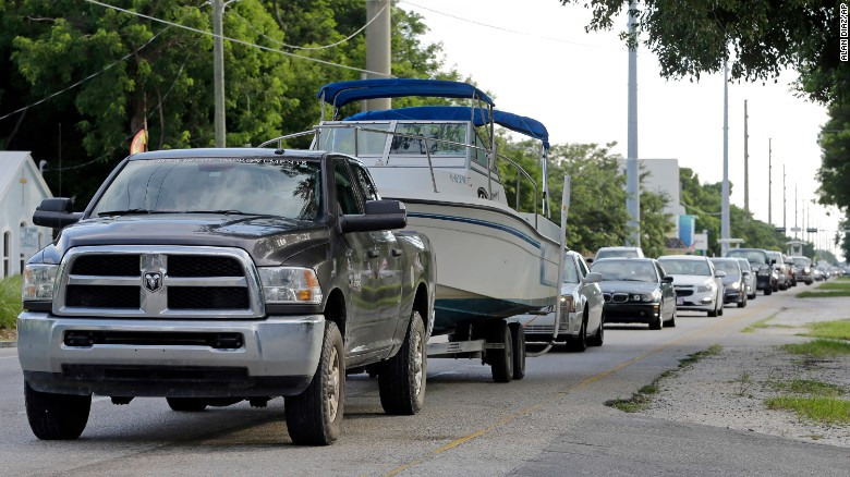 Some residents aim to ride out storm in boats