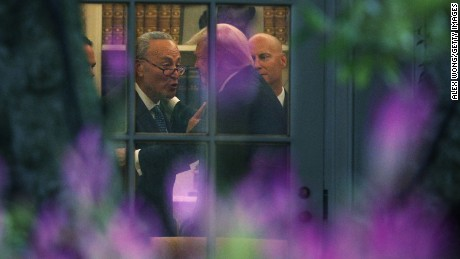 WASHINGTON, DC - SEPTEMBER 06:  Senate Minority Leader Chuck Schumer (D-NY) (L) makes a point to President Donald Trump in the Oval Office prior to his departure from the White House September 6, 2017 in Washington, DC. (Alex Wong/Getty Images)