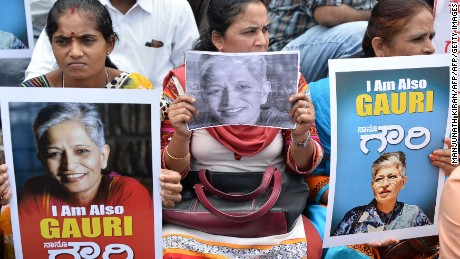 Indian protesters take part in a rally condemning the killing of journalist Gauri Lankesh in Bangalore on September 6, 2017.