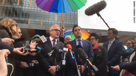 Australian independent political Andrew Wilkie (center left) speaks to media Thursday after High Court knocks down his challenge to same-sex marriage vote.