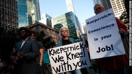 NEW YORK, NY - AUGUST 23: Activists rally in support of NFL quarterback Colin Kaepernick outside the offices of the National Football League on Park Avenue, August 23, 2017 in New York City. During the NFL season last year, Kaepernick caused controversy by kneeling during the National Anthem at games to protest racial oppression and police brutality. Kaepernick is currently a free agent and some critics and analysts claim NFL teams don't want to sign him due to his public display of his political beliefs.