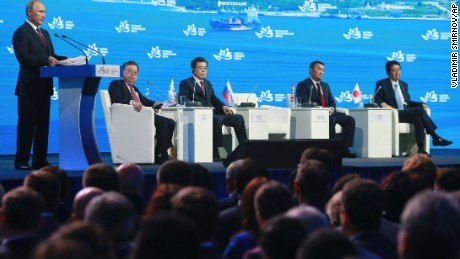 "Russian President Vladimir Putin, left, speaks as South Korea's President Moon Jae-in, third from left, Mongolia's President Khaltmaagiin Battulga, second from right, and Japan's Prime Minister Shinzo Abe, right, listen during a plenary session titled ""The Russian Far East: Creating a New Reality"" at the Eastern Economic Forum in Vladivostok, Russia, Thursday, Sept. 7, 2017. Putin says he believes U.S. President Donald Trump's administration is willing to defuse tensions on the Korean Peninsula. (Vladimir Smirnov/TASS News Agency Pool Photo via AP)"
