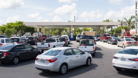 People wait in line in for gas for their cars at a Costco Gas Station as they prepare for Hurricane Irma in Miami, Florida, September 7.