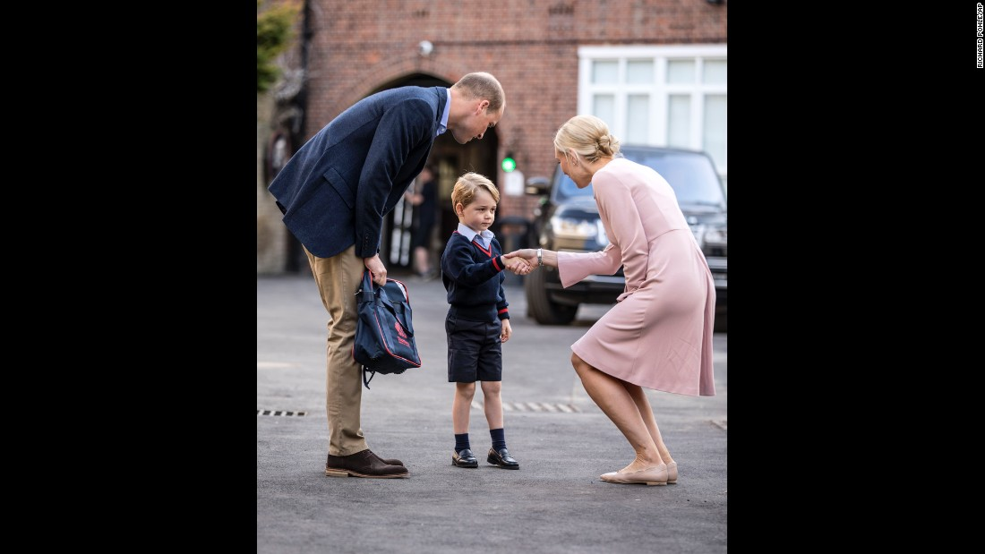 "Britain's Prince George arrives for <a href=""http://www.cnn.com/2017/09/07/europe/prince-george-first-day-school/index.html"" target=""_blank"">his first day of school</a> and is greeted by Helen Haslem, the head of the lower school, on Thursday, September 7. George was brought to school by his father, Prince William."
