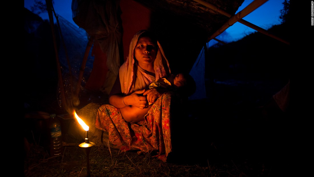 "A Rohingya woman from Myanmar cradles her child at a temporary camp in Bangladesh on Saturday, September 2. More than 120,000 Rohingya <a href=""http://www.cnn.com/2017/09/05/asia/rohingya-mass-protest-report/index.html"" target=""_blank"">have fled to Bangladesh</a> to escape violence in their native Rakhine State, according to a United Nations official in Bangladesh."