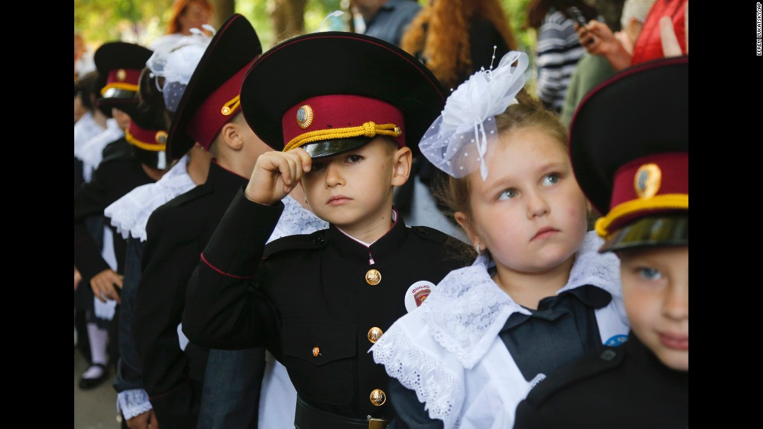Young cadets and schoolgirls attend a ceremony on the first day of school in Kiev, Ukraine, on Friday, September 1.