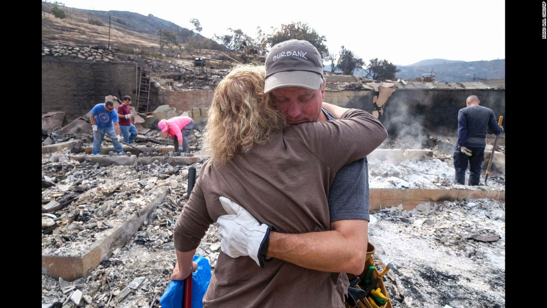 "Craig Bolleson hugs a friend in his burned-out home in Los Angeles on Monday, September 4. A day earlier, the La Tuna brush fire caused Gov. Jerry Brown <a href=""http://www.cnn.com/2017/09/02/us/los-angeles-wildfire/index.html"" target=""_blank"">to issue a state of emergency</a> for Los Angeles County."