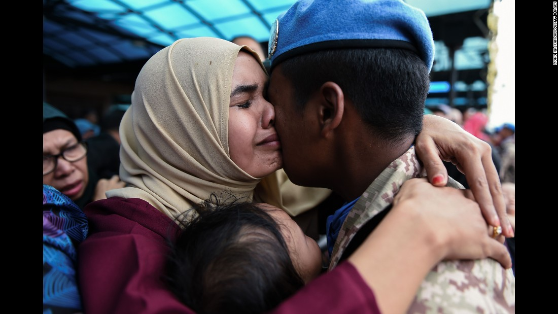 Mohd Farhan, a member of the Malaysian armed forces, hugs his wife Siti Salwa on Thursday, September 7, before leaving for Lebanon. Malaysia sent about 850 troops to Lebanon to take part in UN peacekeeping activities.