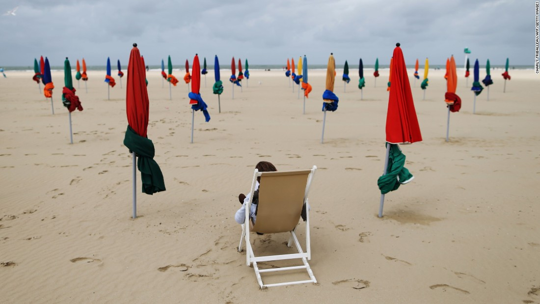 A man sitting in a deckchair reads on a beach in Deauville, France, on Wednesday, September 6.