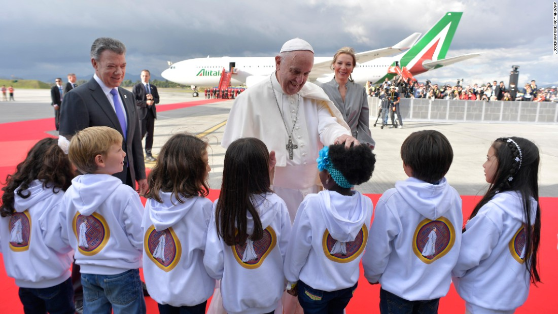 "Pope Francis, standing with Colombian President Juan Manuel Santos and first lady Maria Clemencia Rodriguez, greets children Wednesday, September 6, during a welcoming ceremony in Bogota, Colombia. The Pope is <a href=""http://www.cnn.com/2017/09/07/americas/gallery/pope-francis-colombia-visit/index.html"" target=""_blank"">in Colombia this week</a> on a peace-building initiative."