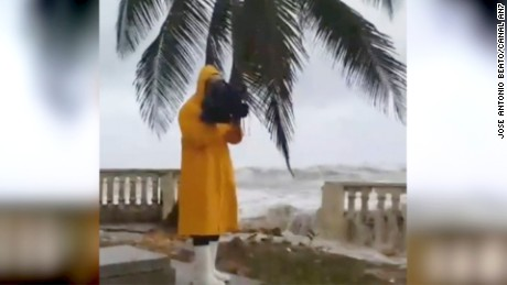 Cameraman almost wiped out by Irma's waves