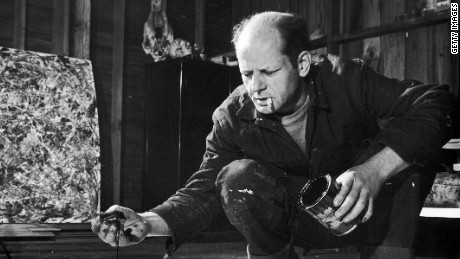 Painter Jackson Pollock, cigarette in mouth, dropping paint onto canvas.  (Photo by Martha Holmes/The LIFE Picture Collection/Getty Images)